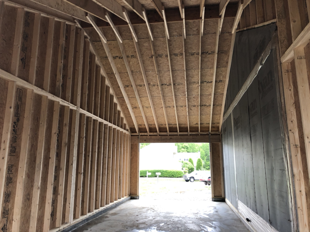 12x32 attached garage built with an open rafter ceiling for overhead room for lift One Car Amish Garages