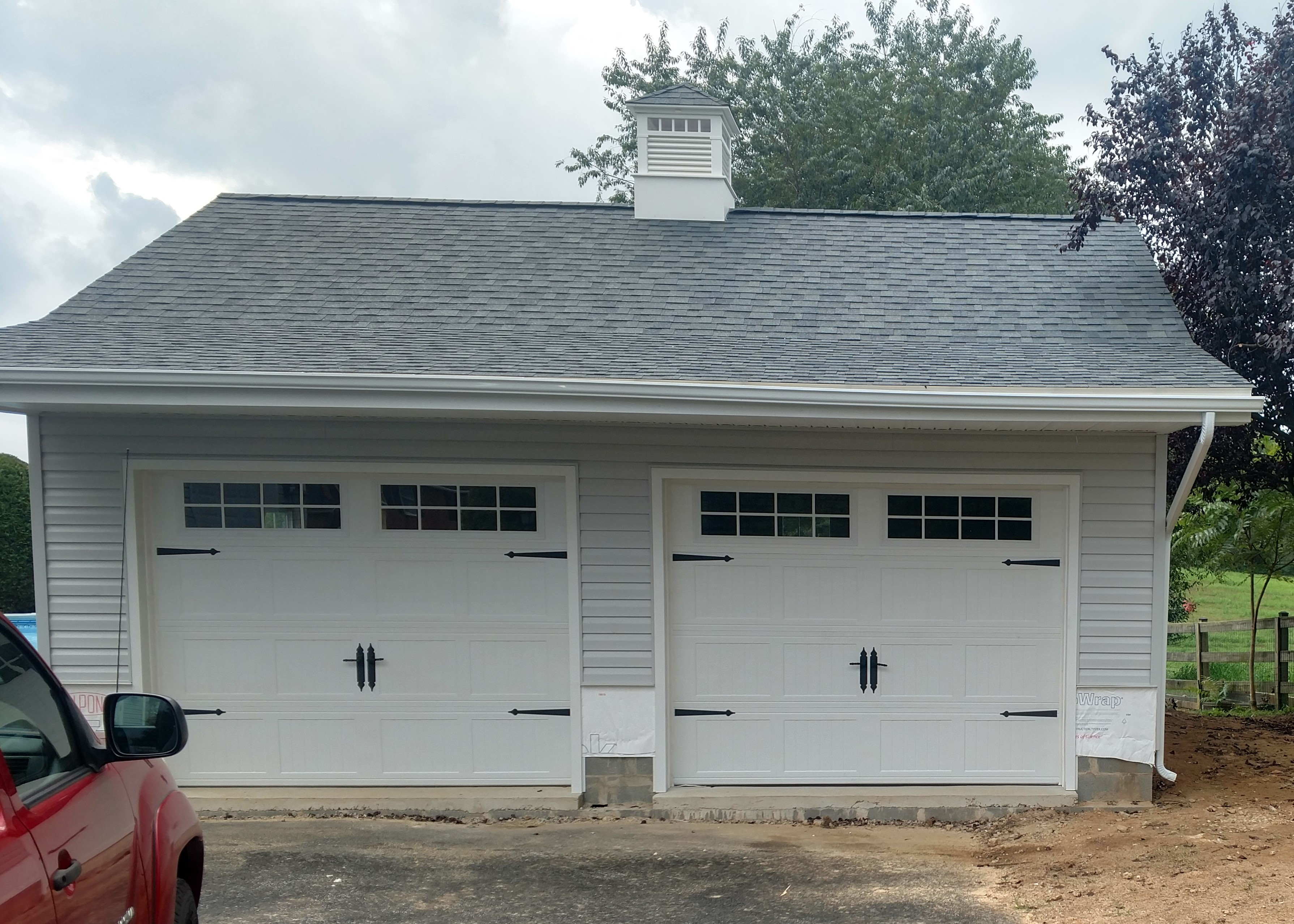 24x24 7 12 extended truss front overhang Two Car Garages